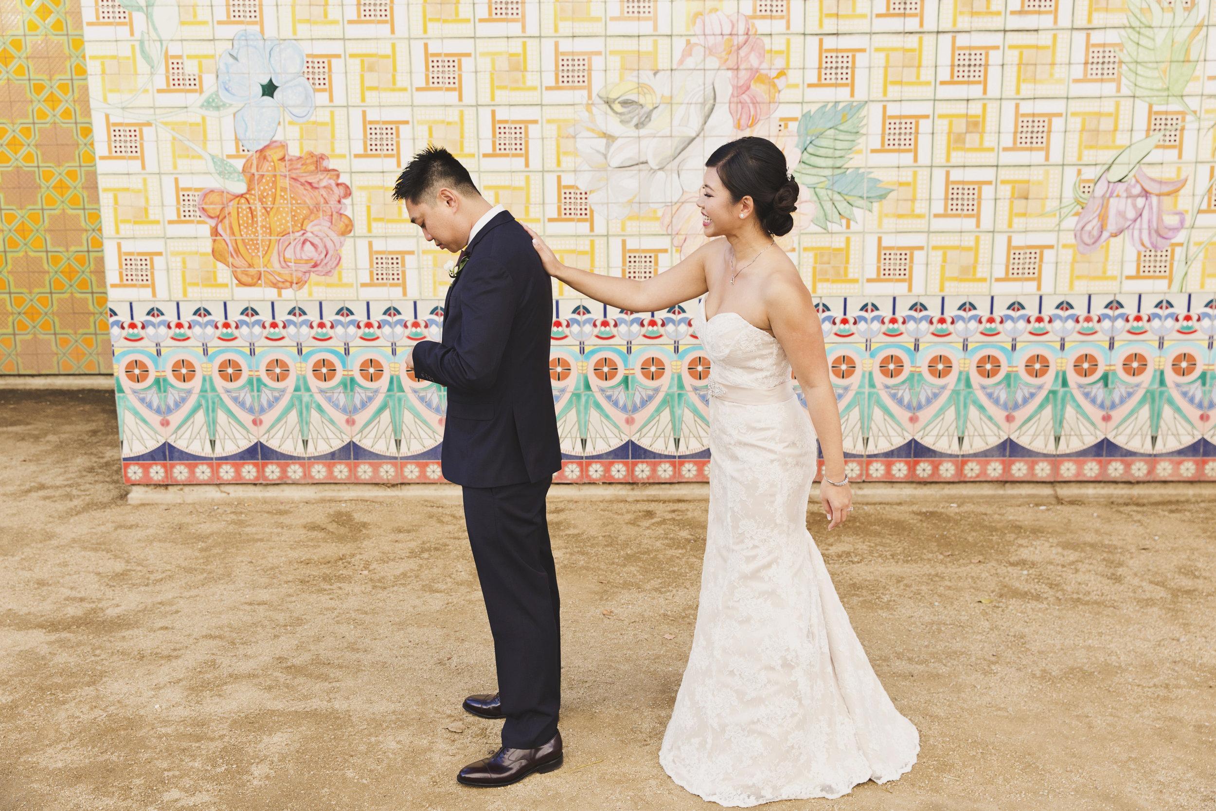 Beautiful Traditional Modern Chinese Wedding bride sneaks up on groom before first look.jpg