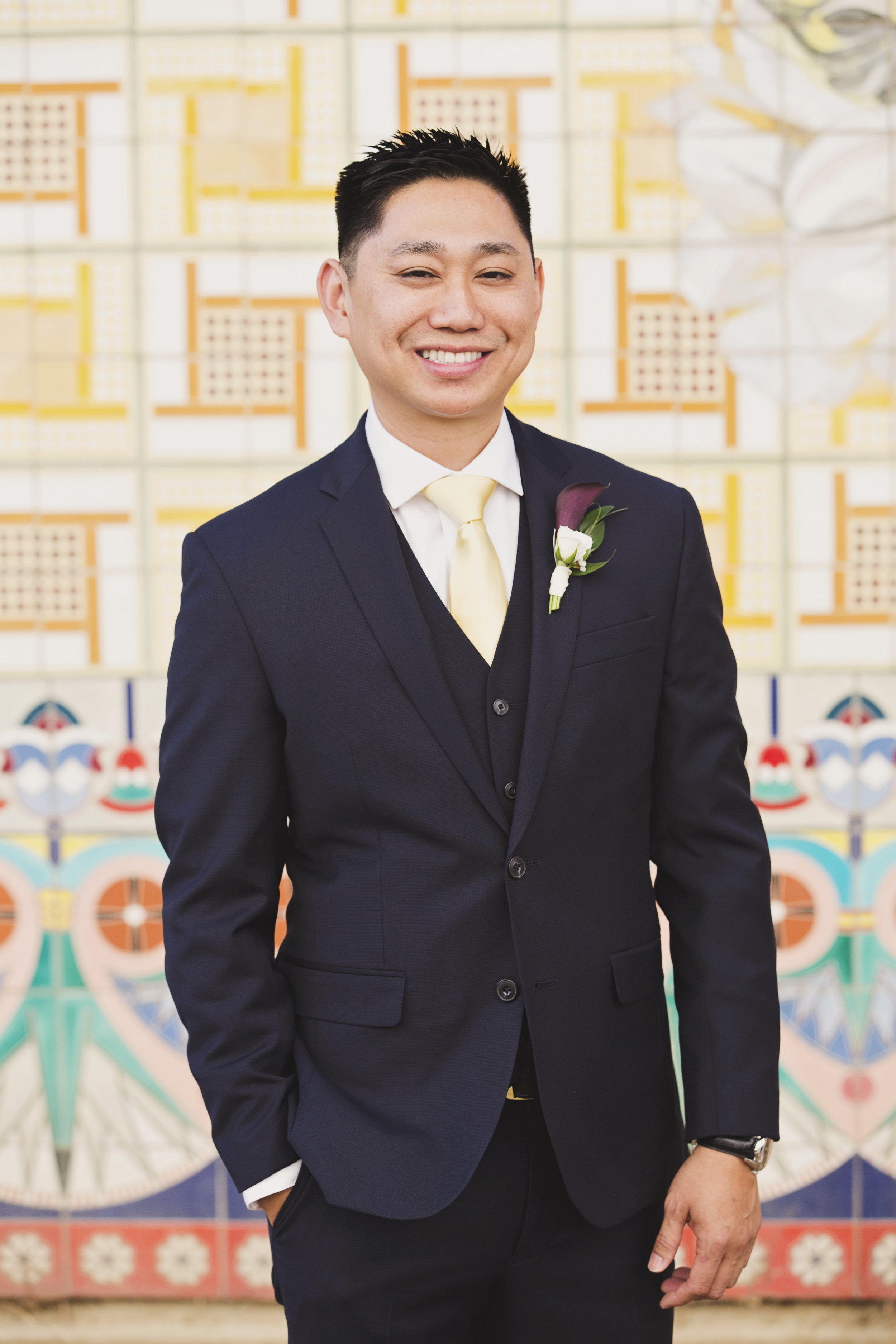 Beautiful Traditional Modern Chinese Wedding groom with simple red boutonniere.jpg