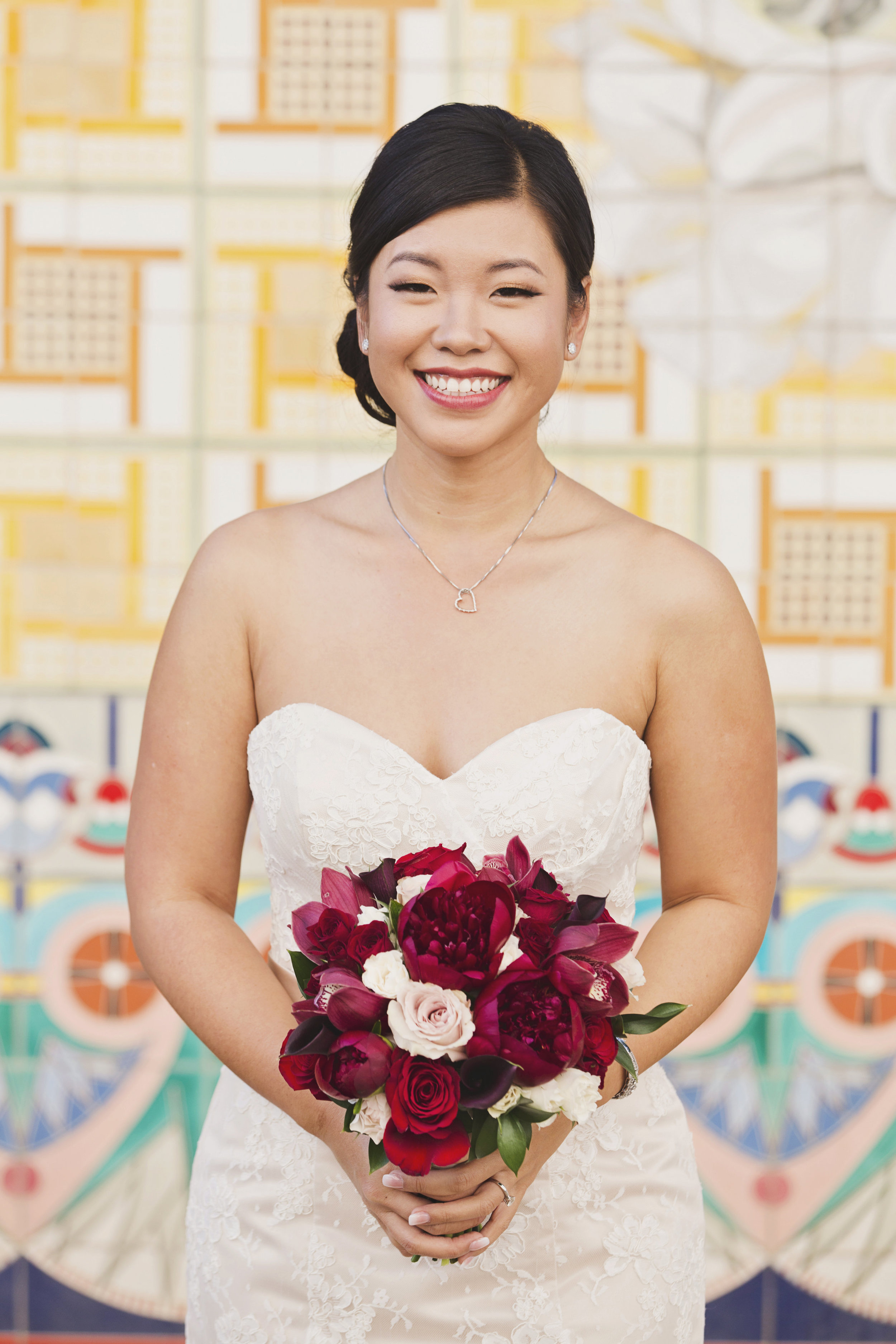 Beautiful Traditional Modern Chinese Wedding bride with gorgeous red floral bouquet.jpg