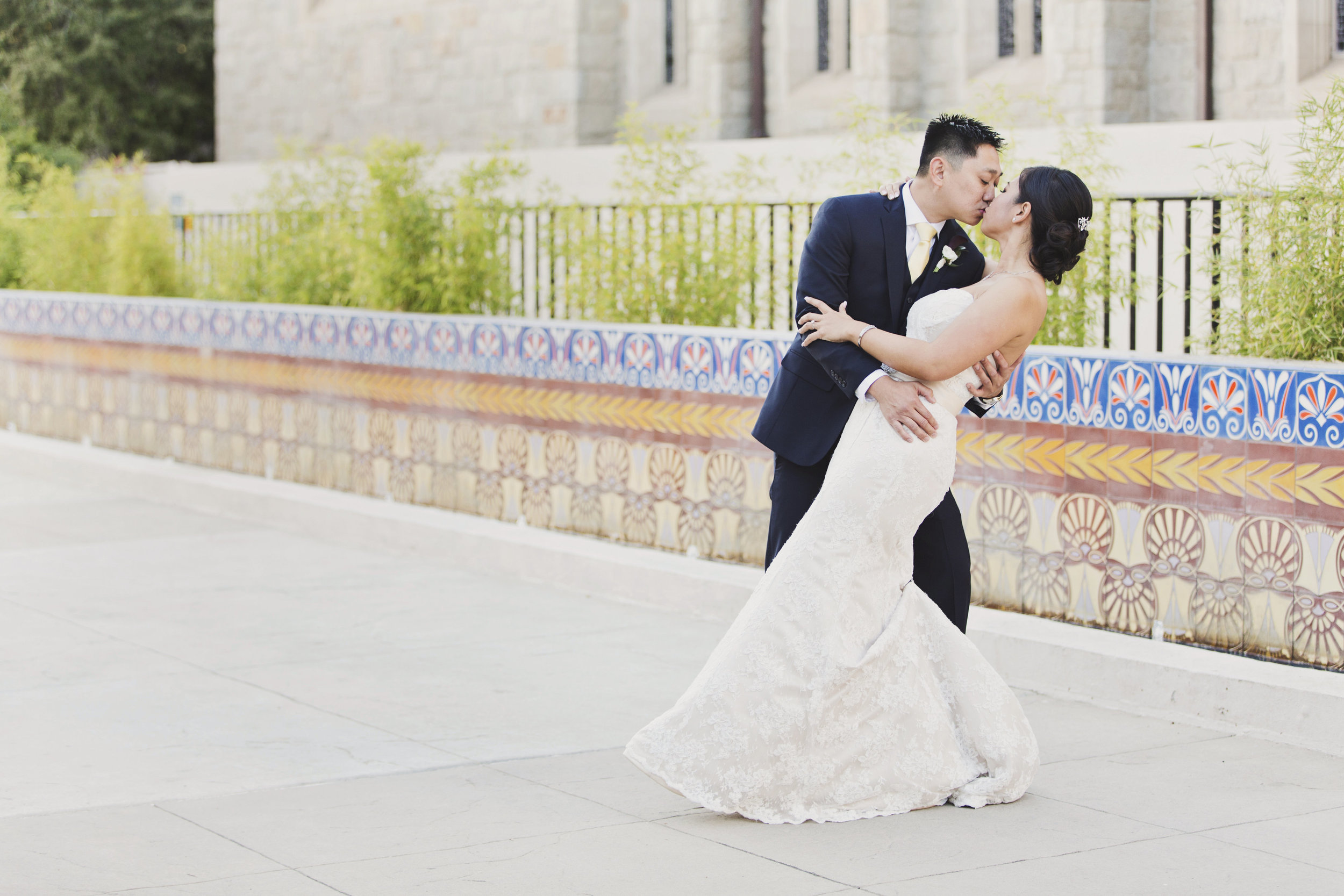 Beautiful Traditional Modern Chinese Wedding bride and groom share a kiss in front of Pasadena City Hall.jpg