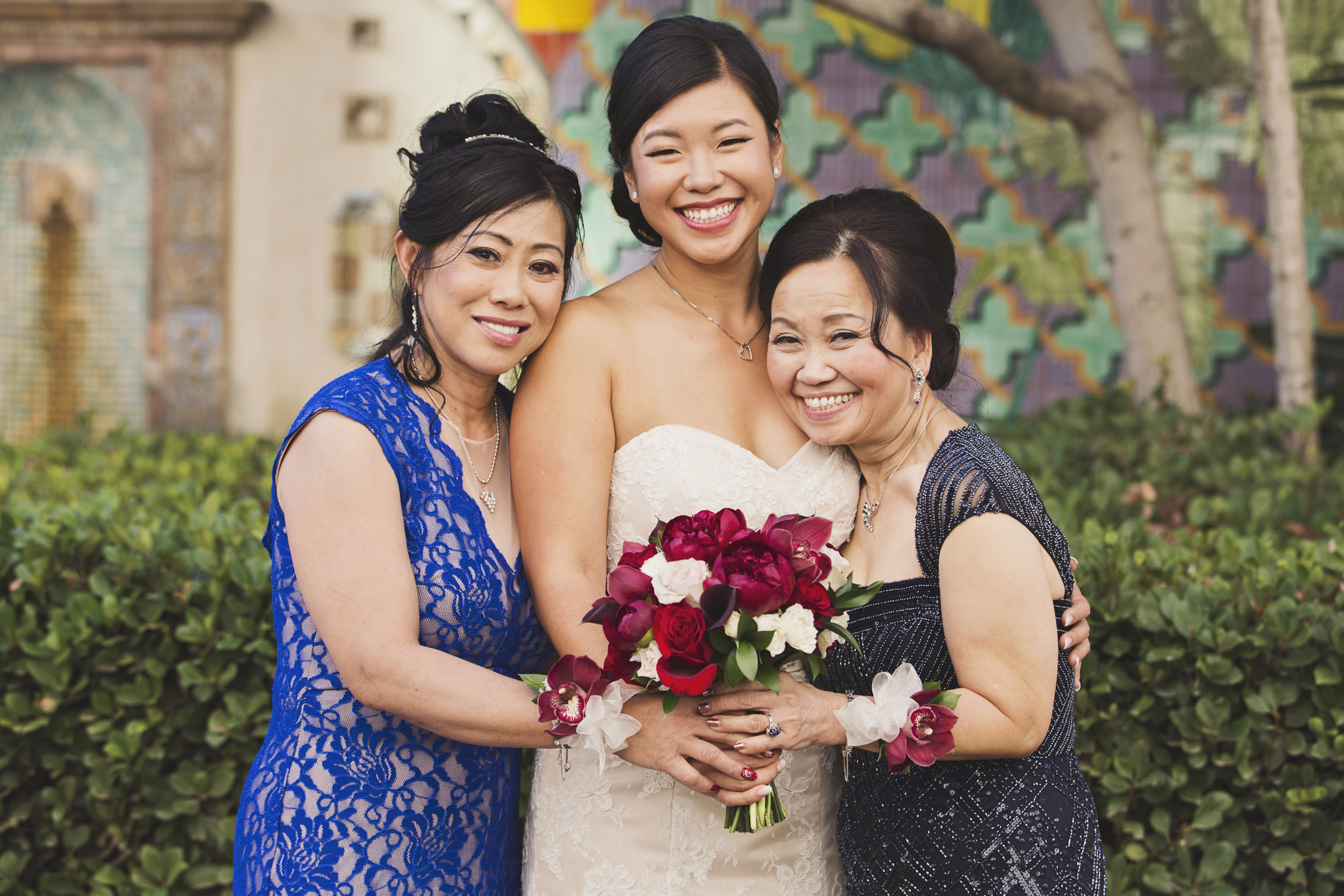 Beautiful Traditional Modern Chinese Wedding bride with the moms.jpg