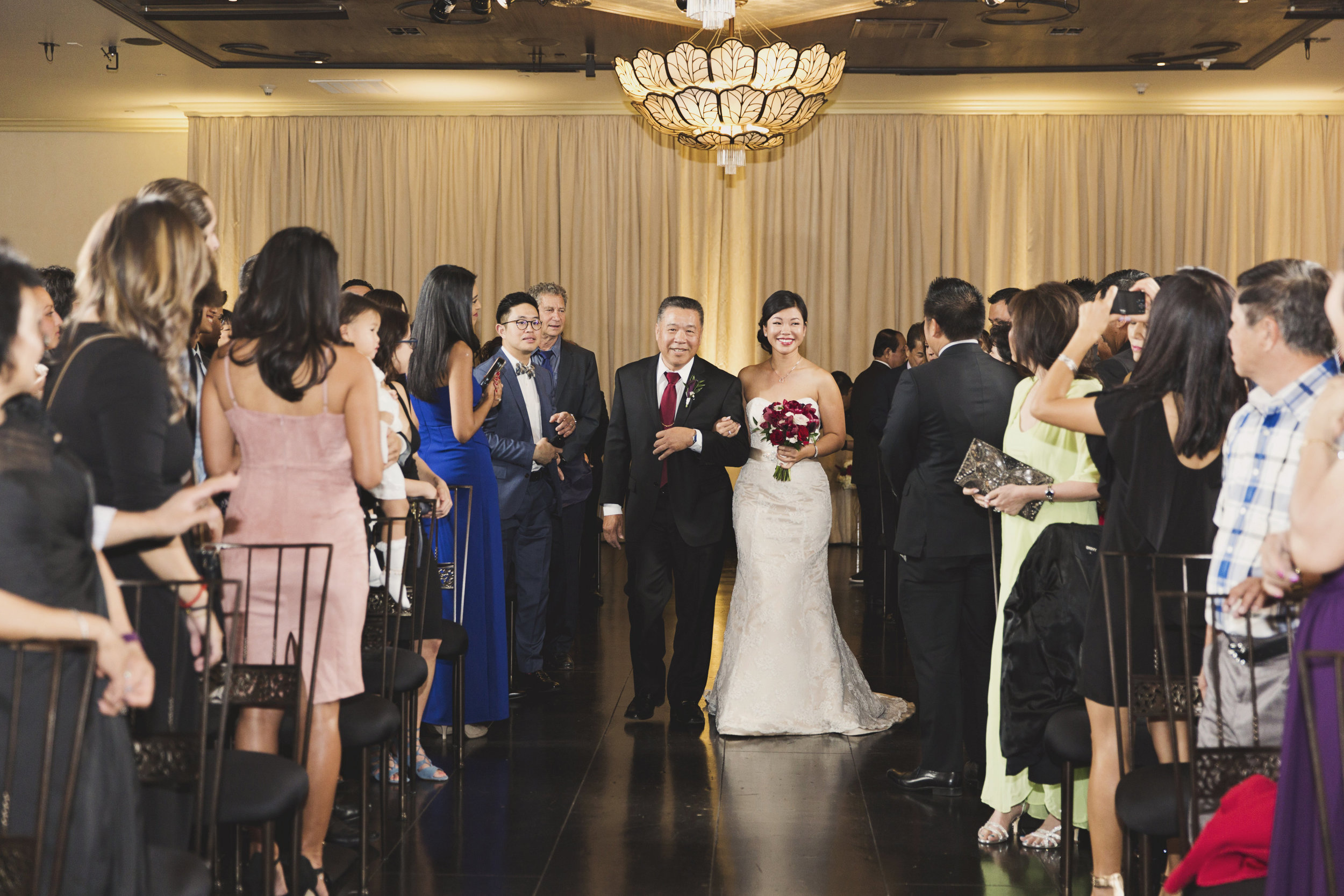 Beautiful Traditional Modern Chinese Wedding bride enters on the arm of her father.jpg