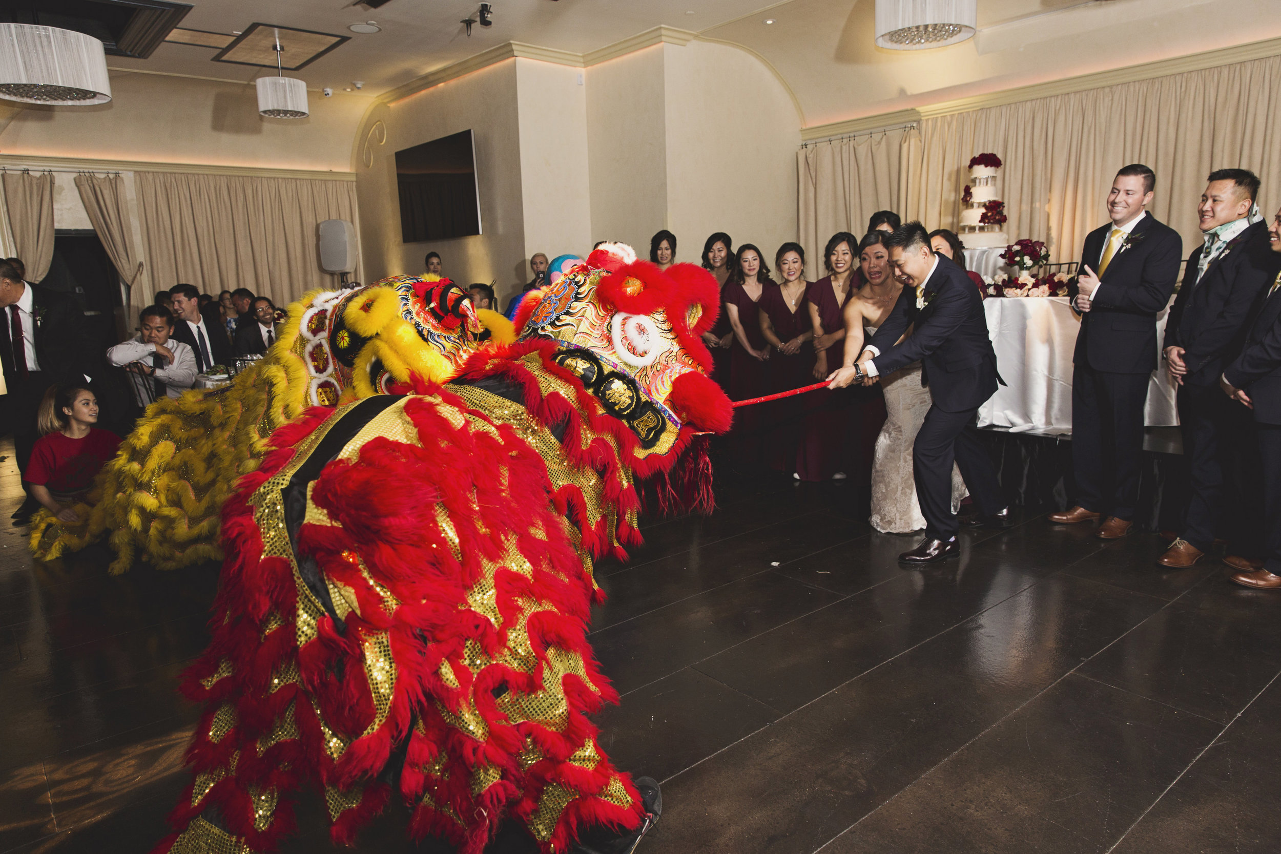 Beautiful Traditional Modern Chinese Wedding dragon makes an entrance.jpg