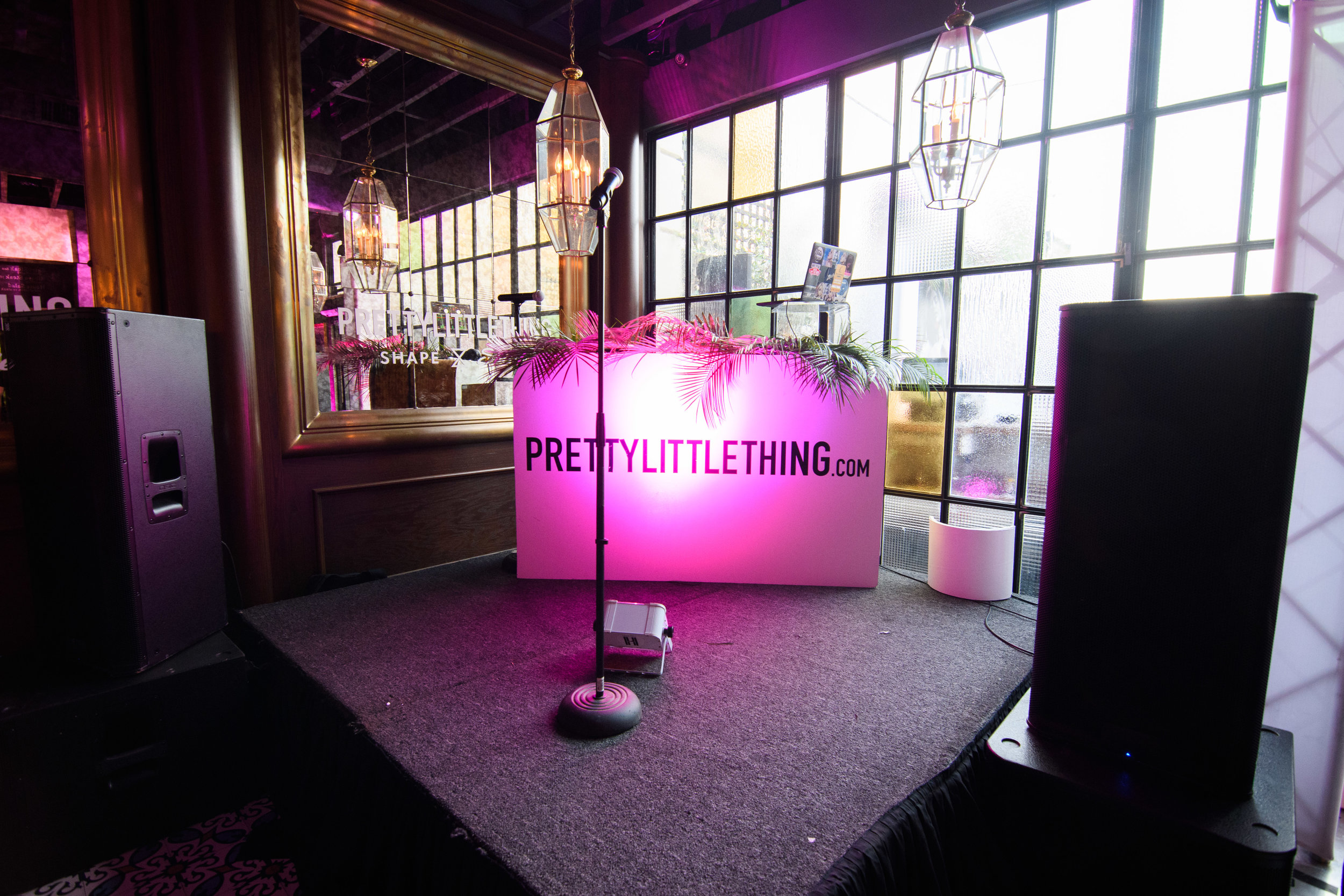 PrettyLittleThing New PLT Shape Collection with Stassie Celebrity Launch Party pink lighted DJ booth.jpg