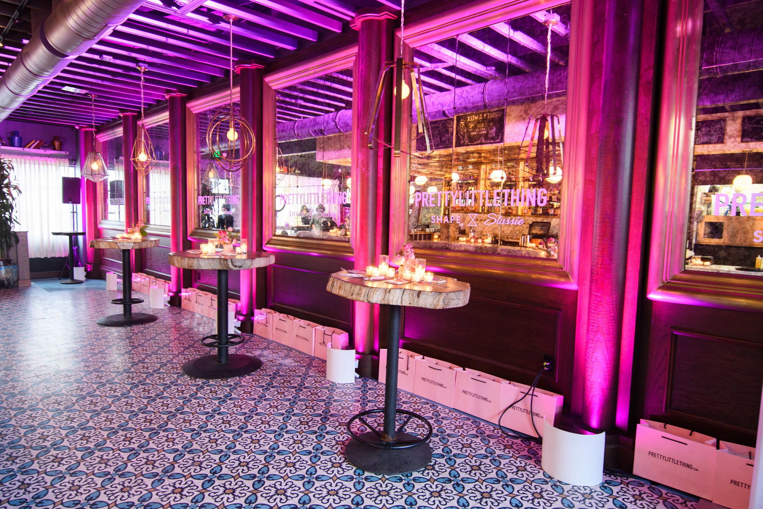 PrettyLittleThing New PLT Shape Collection with Stassie Celebrity Launch Party The Phoenix LA bar with pink lighting.jpg