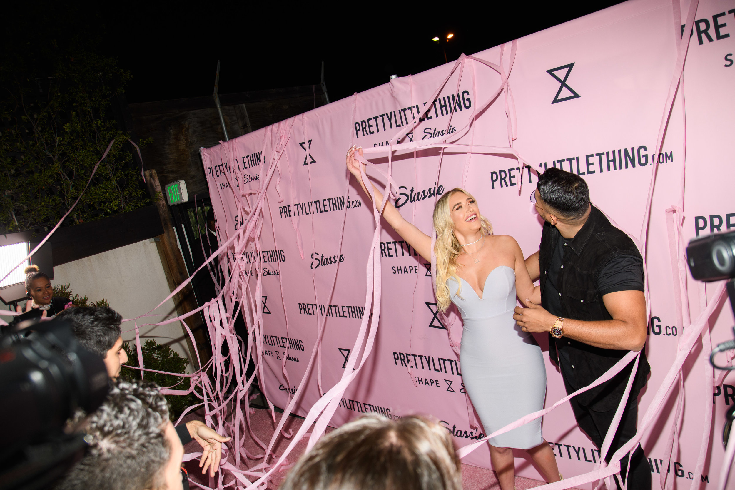 PrettyLittleThing New PLT Shape Collection with Stassie Celebrity Launch Party Stassiebaby and Umar Kamani love the pink streamers.jpg