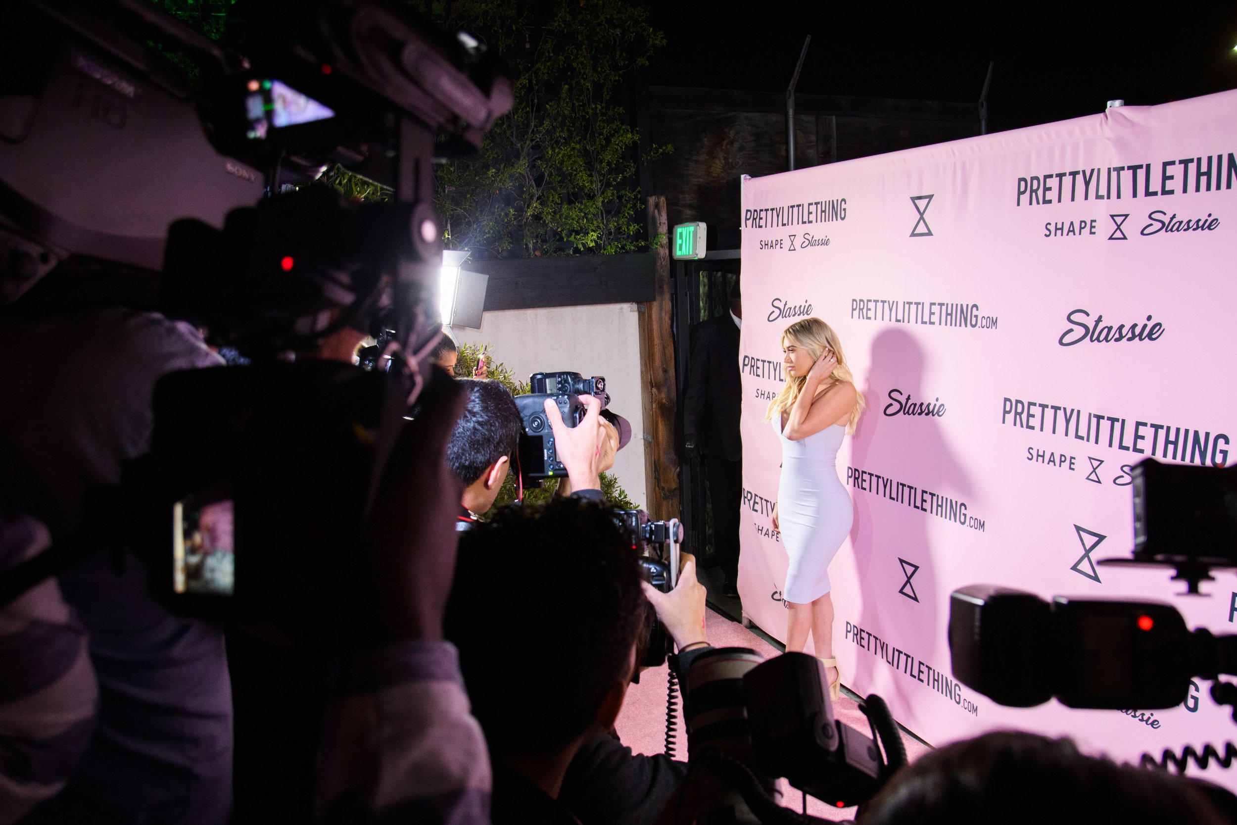 PrettyLittleThing New PLT Shape Collection with Stassie Celebrity Launch Party Stassiebaby stopping for a pic.jpg