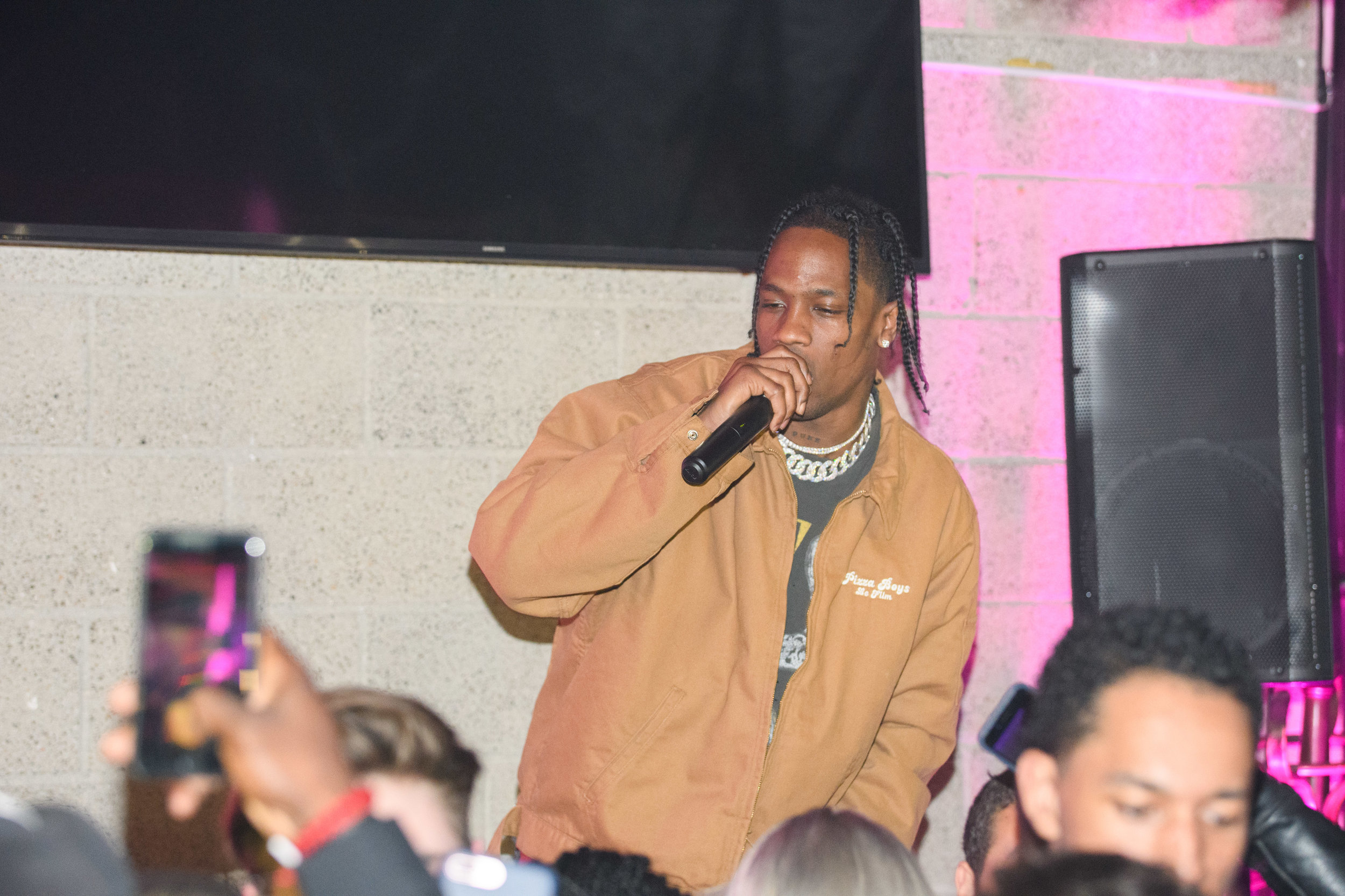 PrettyLittleThing New PLT Shape Collection with Stassie Celebrity Launch Party Travis Scott performs for the crowd.jpg
