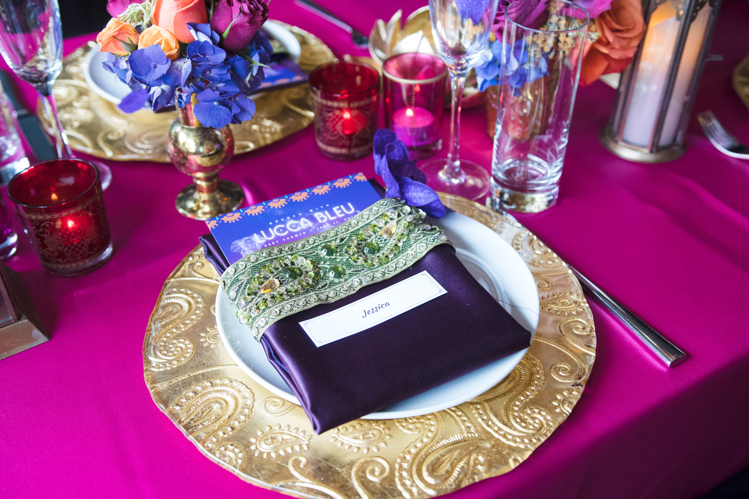 Moroccan Inspired Baby Shower Party custom linens looked beautiful on gold chargers.jpg