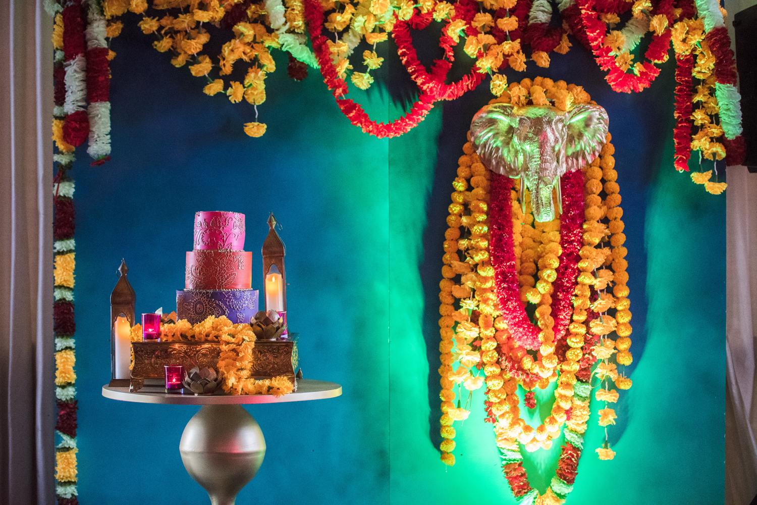 Moroccan Inspired Baby Shower Party amazing floral backdrop with cake.jpg