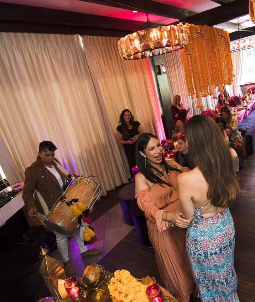 Moroccan Inspired Baby Shower Party Loriann dancing with guest.jpg