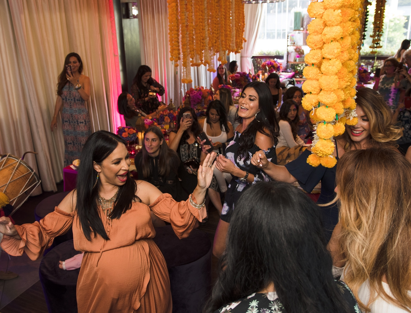Moroccan Inspired Baby Shower Party Loriann dancing with guests.jpg