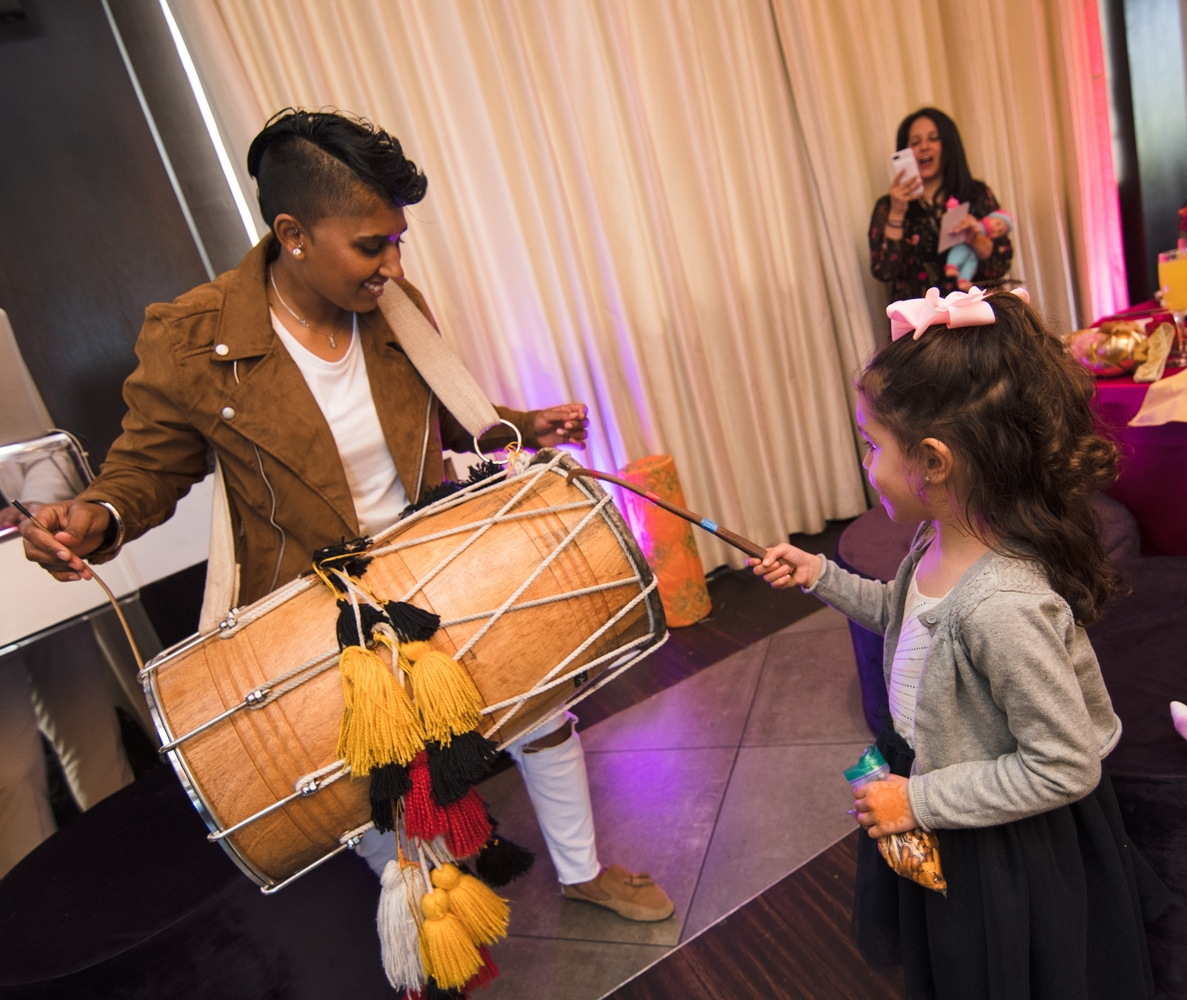 Moroccan Inspired Baby Shower Party little guest trying out the dhol.jpg