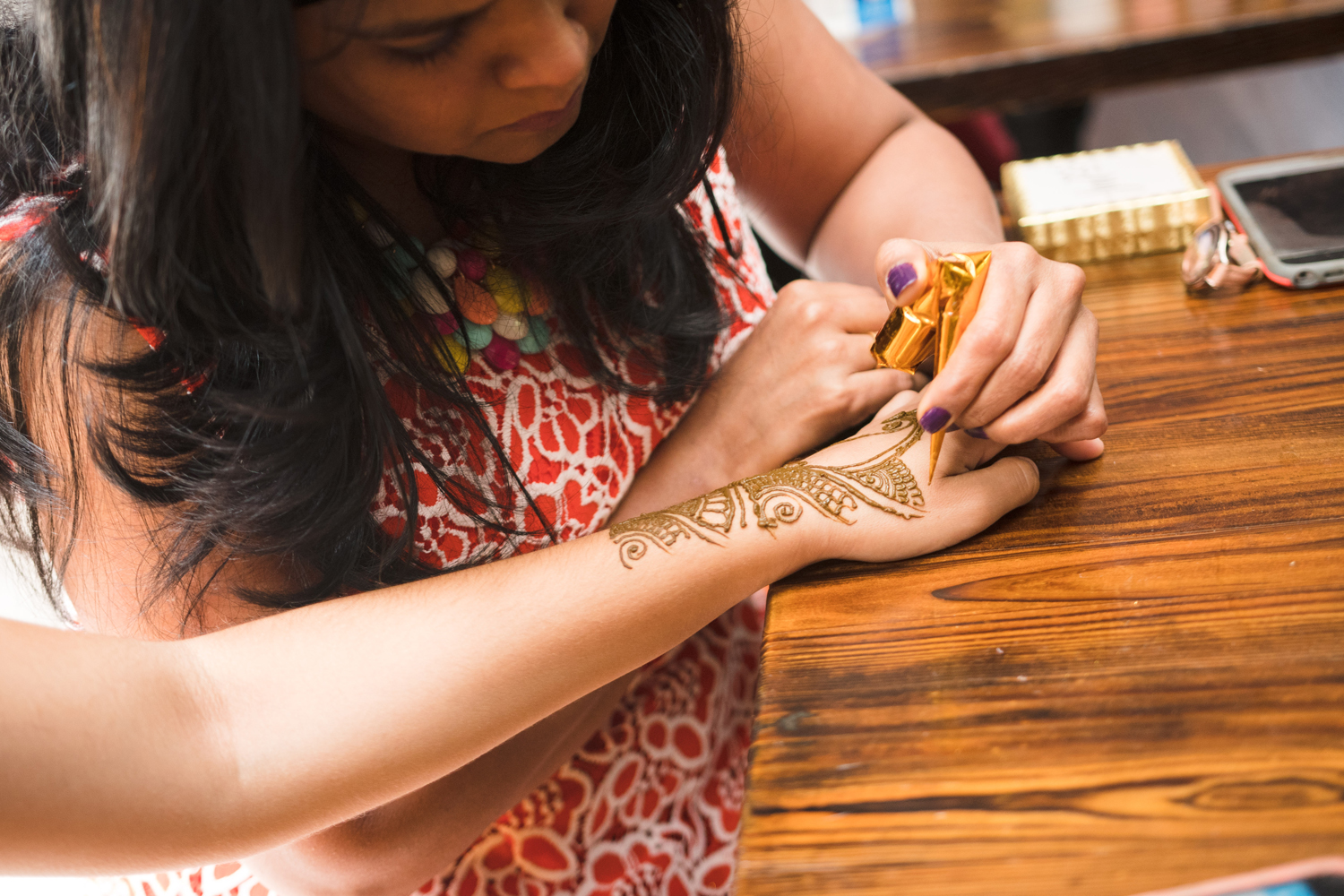Moroccan Inspired Baby Shower Party guests enjoyed henna tattoos.jpg