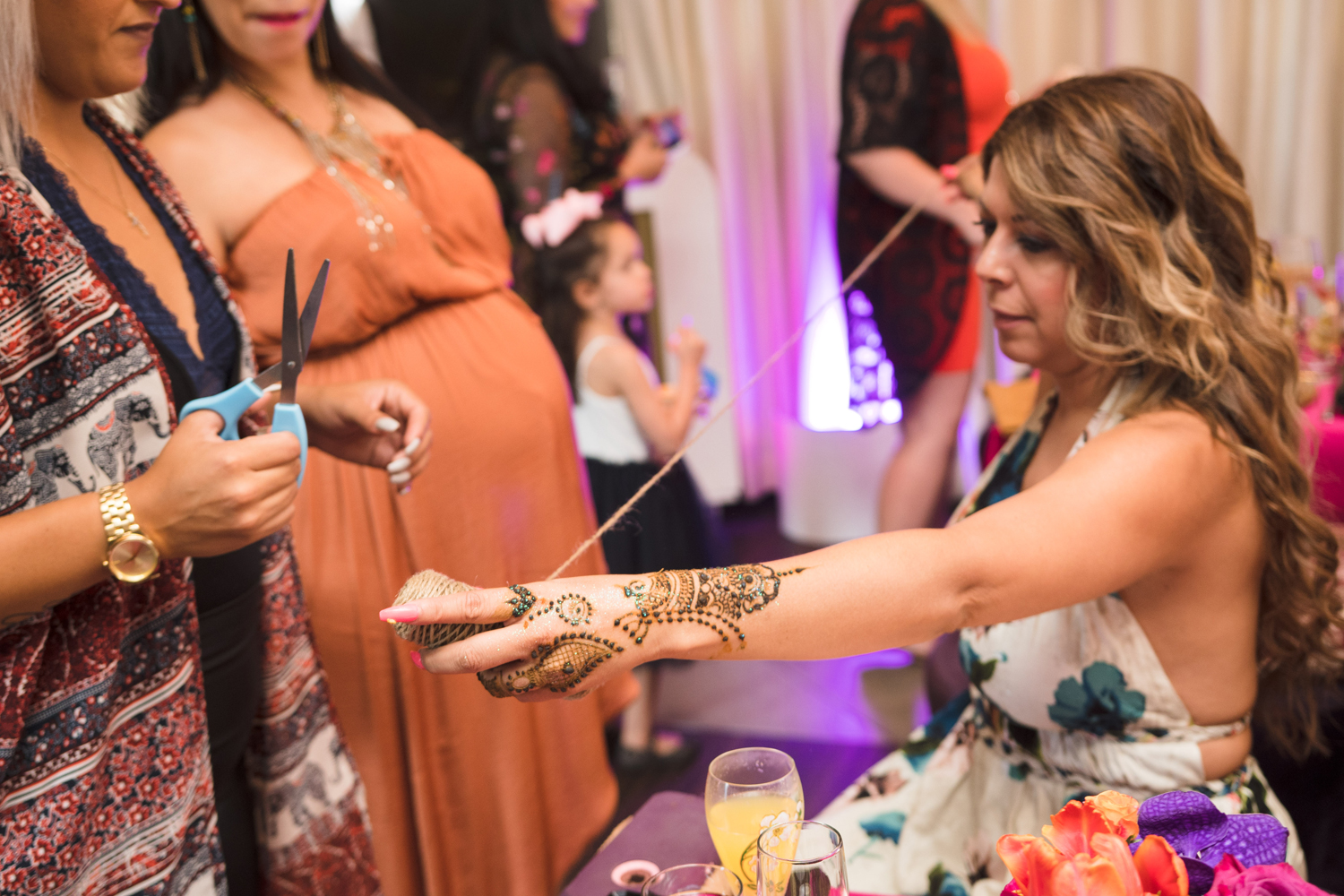 Moroccan Inspired Baby Shower Party can you guess how big Lorianns belly is.jpg
