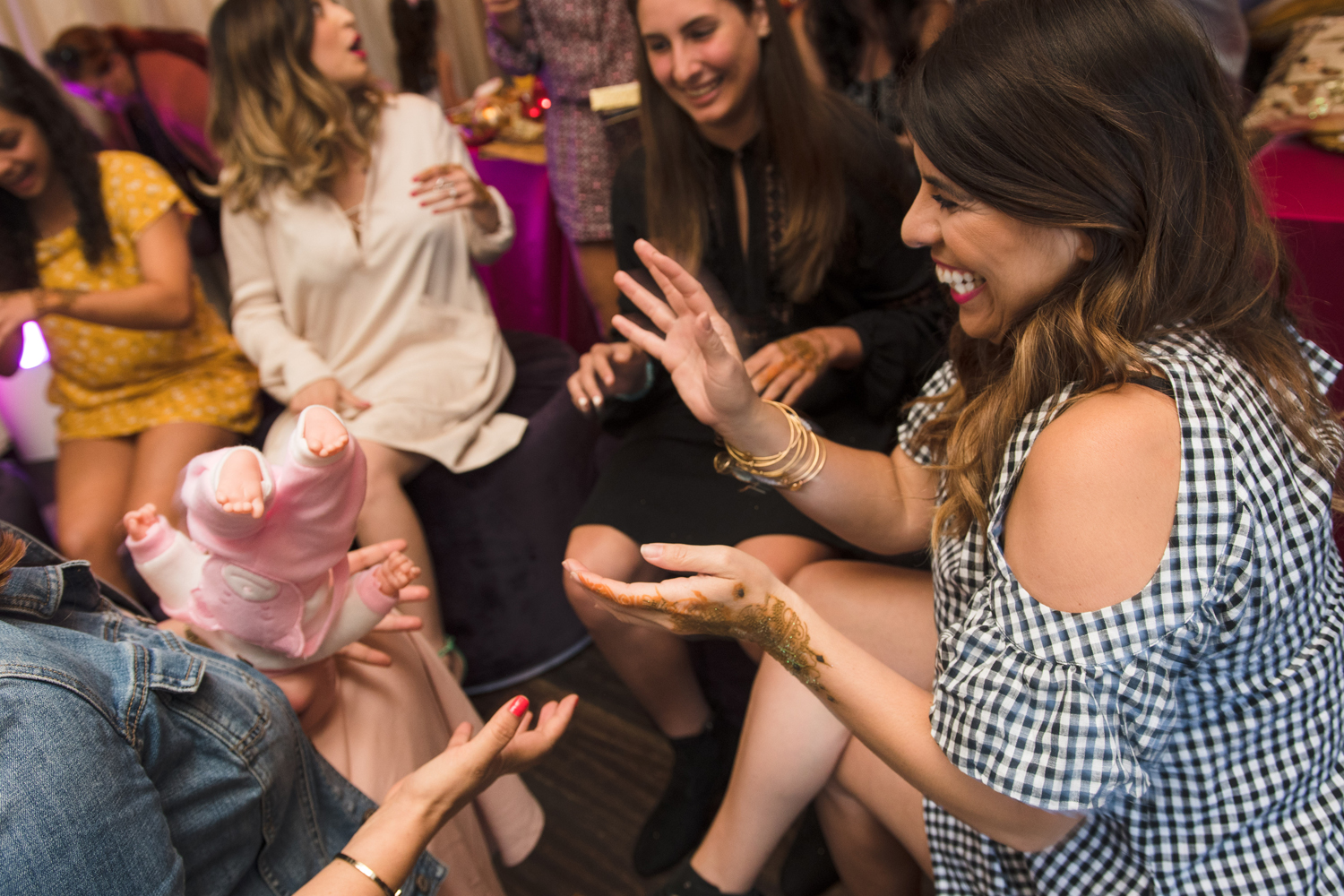 Moroccan Inspired Baby Shower Party guests play pass the baby game.jpg