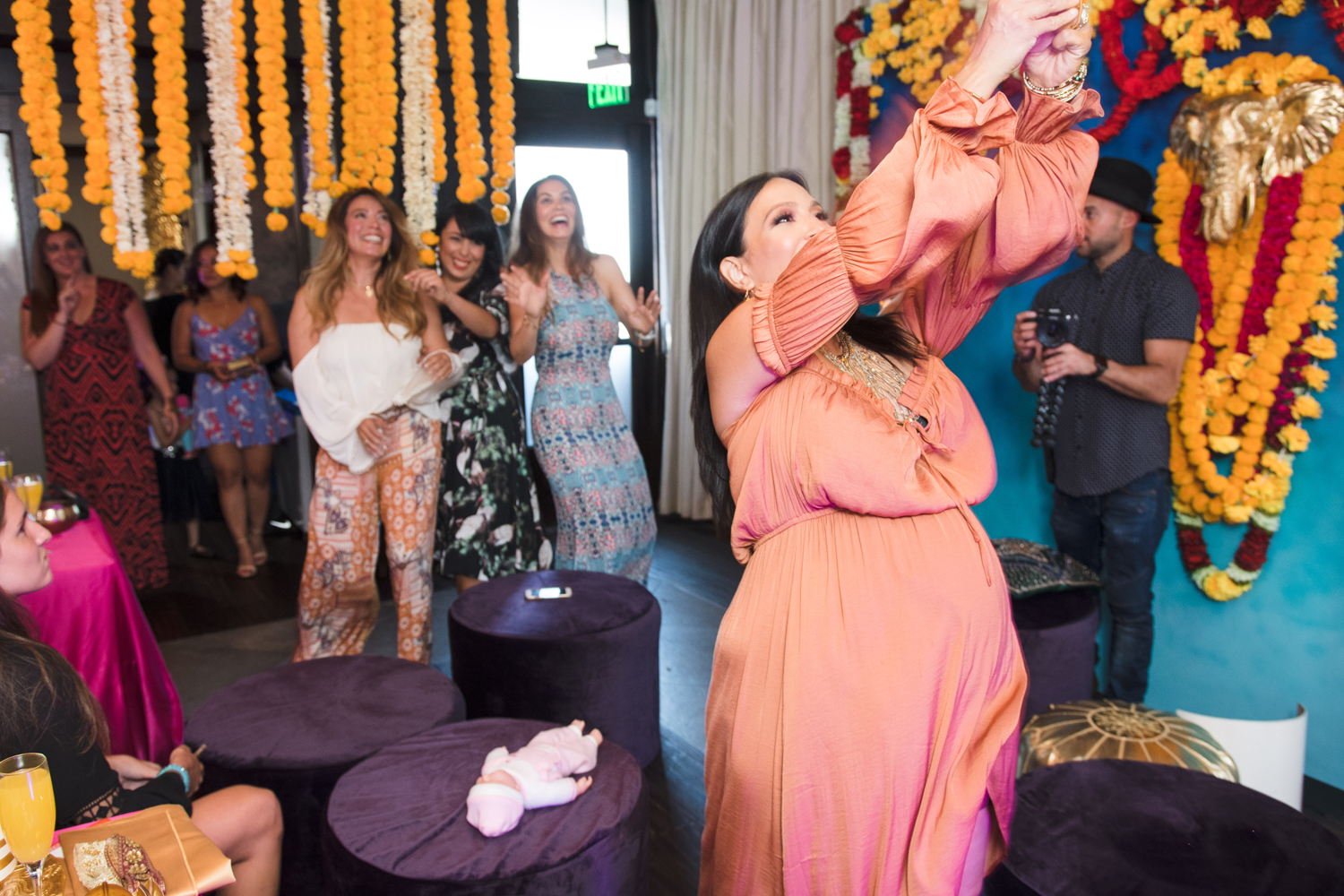 Moroccan Inspired Baby Shower Party tossing the baby to the guests.jpg