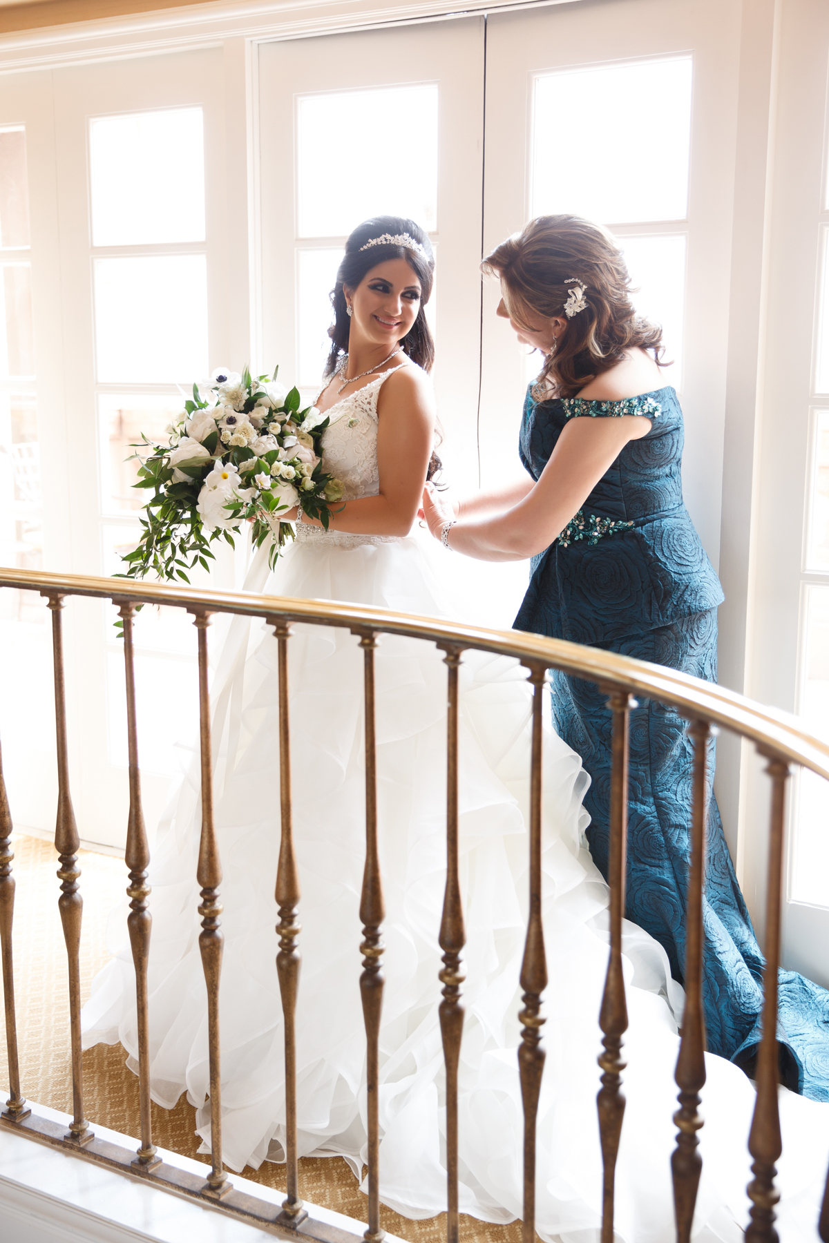 Elegant Pasadena Wedding to Make You Swoon bride's mom final touches on gown.jpg