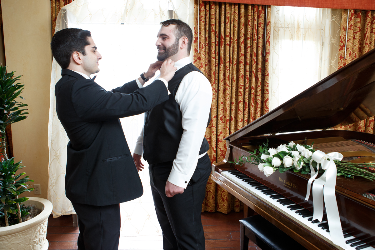 Elegant Pasadena Wedding to Make You Swoon groomsman helping groom with tie.jpg