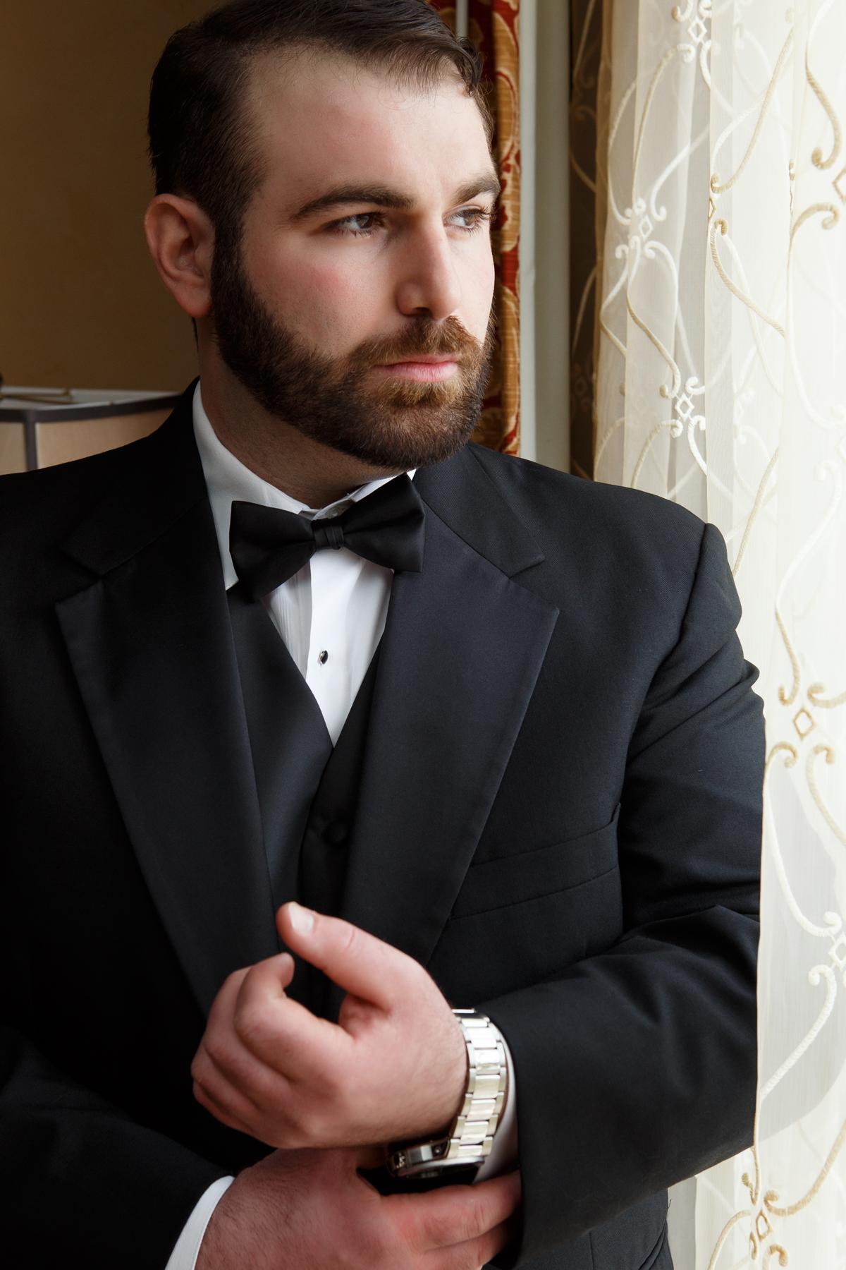Elegant Pasadena Wedding to Make You Swoon groom looking out the window.jpg