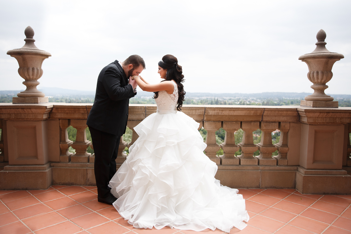 Elegant Pasadena Wedding to Make You Swoon groom kissing brides hand after first look.jpg