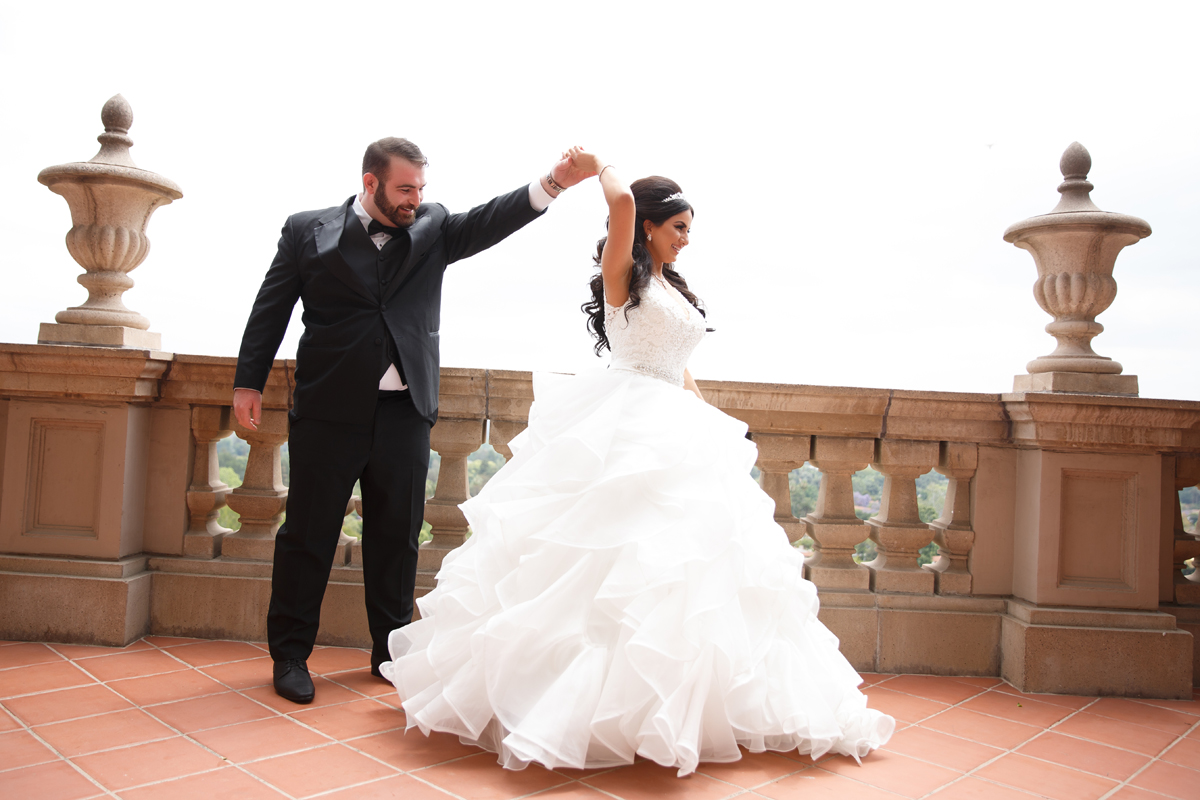 Elegant Pasadena Wedding to Make You Swoon groom twirling bride in beautiful gown.jpg