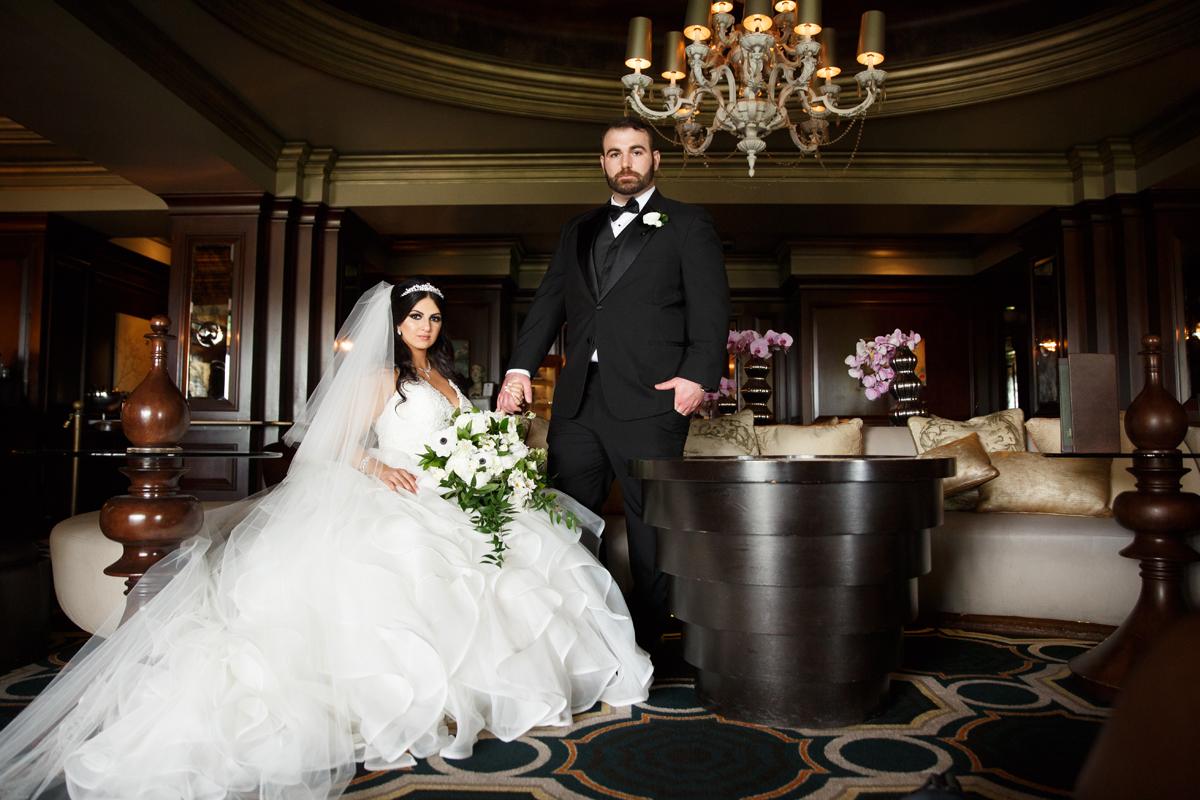 Elegant Pasadena Wedding to Make You Swoon bride and groom pose for classic photo.jpg