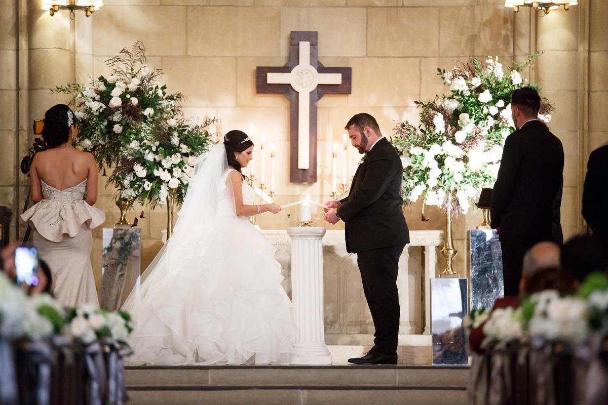 Elegant Pasadena Wedding to Make You Swoon bride and groom lighting candle.jpg