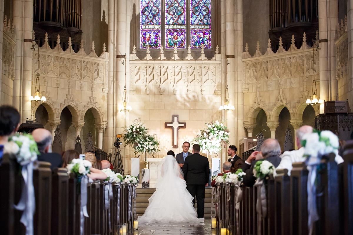 Elegant Pasadena Wedding to Make You Swoon bride and groom in church.jpg