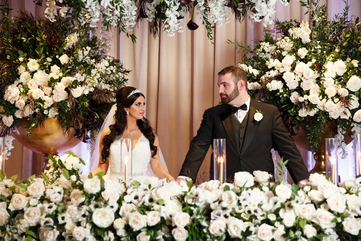 Elegant Pasadena Wedding to Make You Swoon bride and groom at sweetheart table.jpg