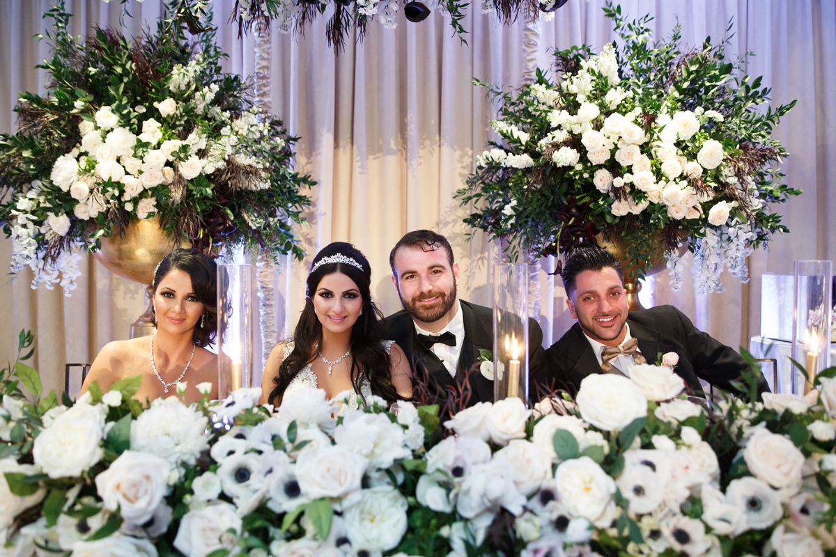 Elegant Pasadena Wedding to Make You Swoon bride groom made of honor and best man at sweetheart table.jpg