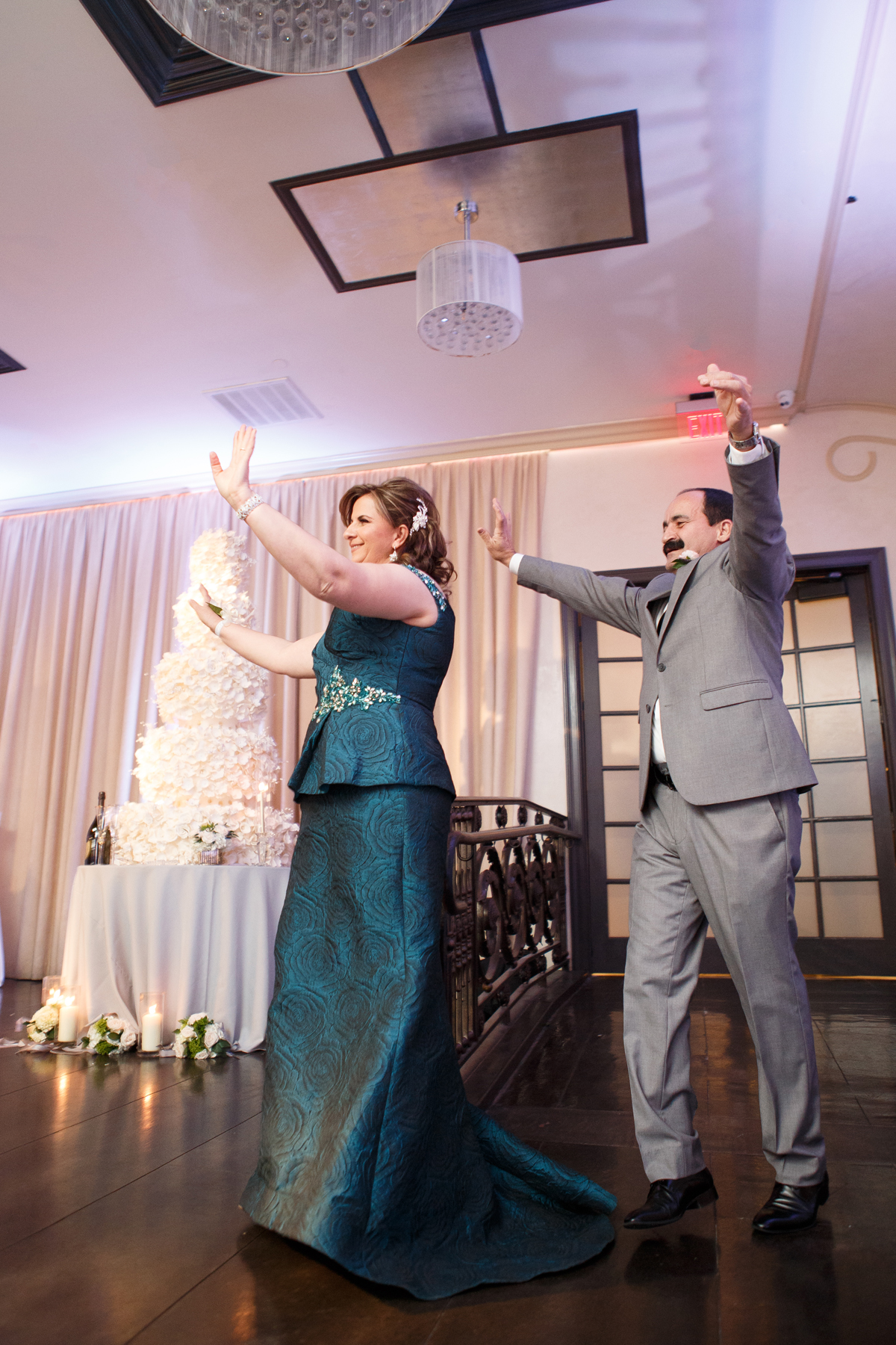 Elegant Pasadena Wedding to Make You Swoon mother and father of the bride enter reception.jpg
