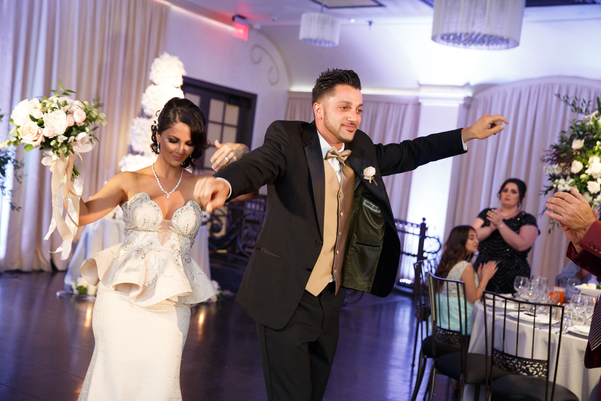 Elegant Pasadena Wedding to Make You Swoon made of honor and best man entering reception.jpg