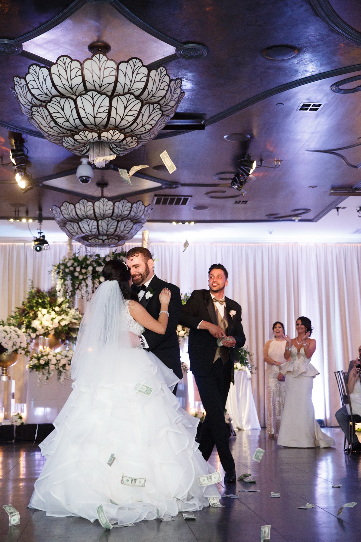 Elegant Pasadena Wedding to Make You Swoon first dance and best man throwing cash.jpg