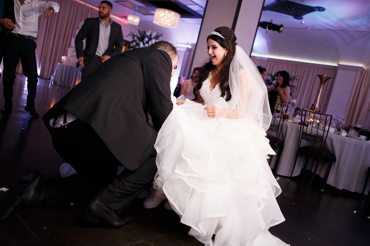 Elegant Pasadena Wedding to Make You Swoon groom removing garter.jpg