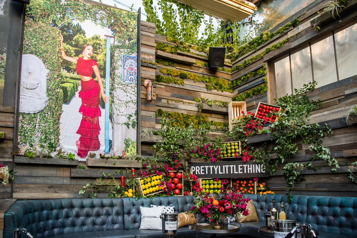 PrettyLittleThing PLT X Olivia Culpo Collection  Celebrity Launch Party large poster of Olivia above seating area.jpg