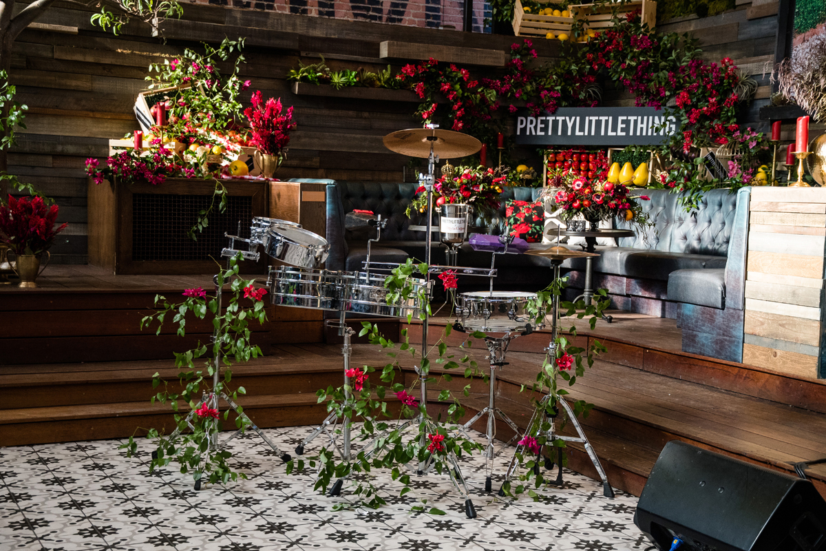 PrettyLittleThing PLT X Olivia Culpo Collection  Celebrity Launch Party drum set decorated with florals.jpg