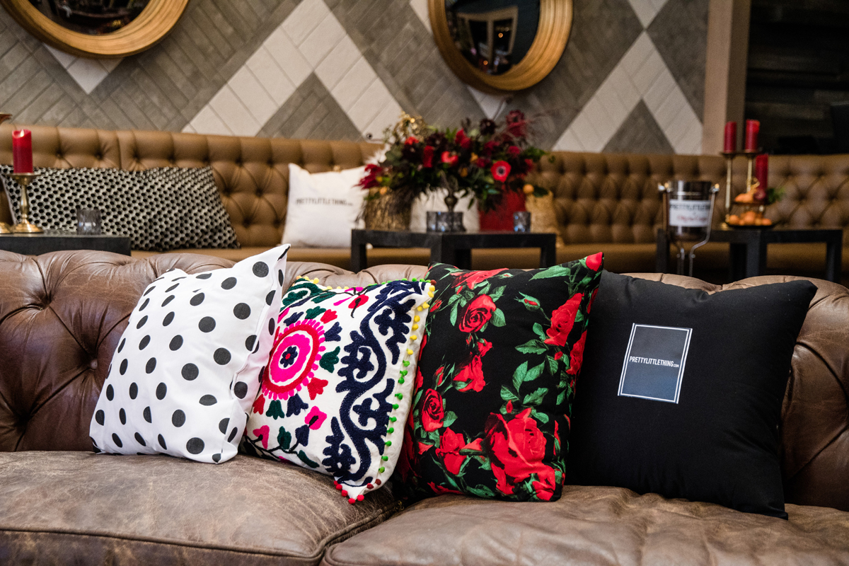 PrettyLittleThing PLT X Olivia Culpo Collection  Celebrity Launch Party decorative pillows add a splash of color.jpg