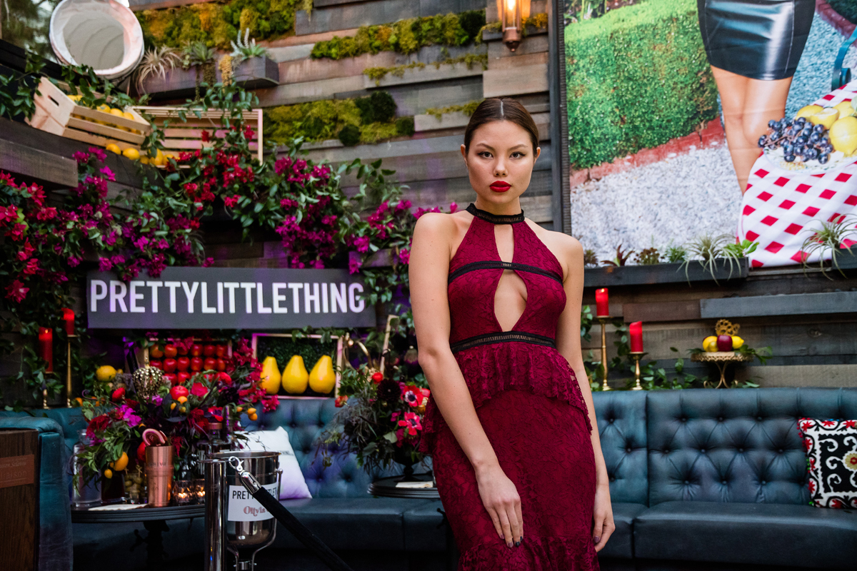 PrettyLittleThing PLT X Olivia Culpo Collection  Celebrity Launch Party model wearing burgundy gown.jpg