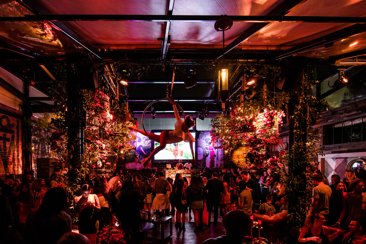 PrettyLittleThing PLT X Olivia Culpo Collection  Celebrity Launch Party aerialist flying high above the crowd.jpg