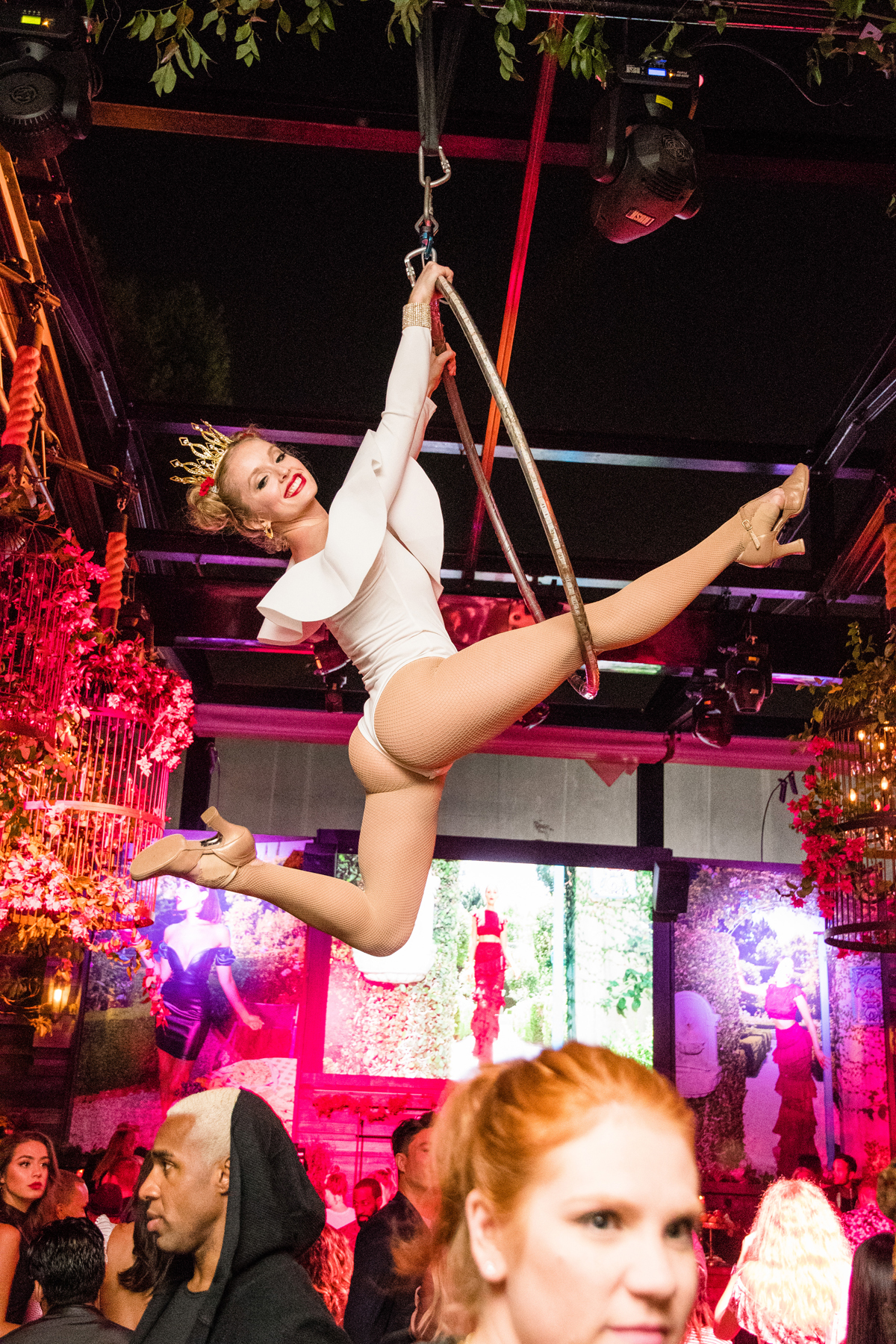PrettyLittleThing PLT X Olivia Culpo Collection  Celebrity Launch Party aerialist spins above the crowd.jpg