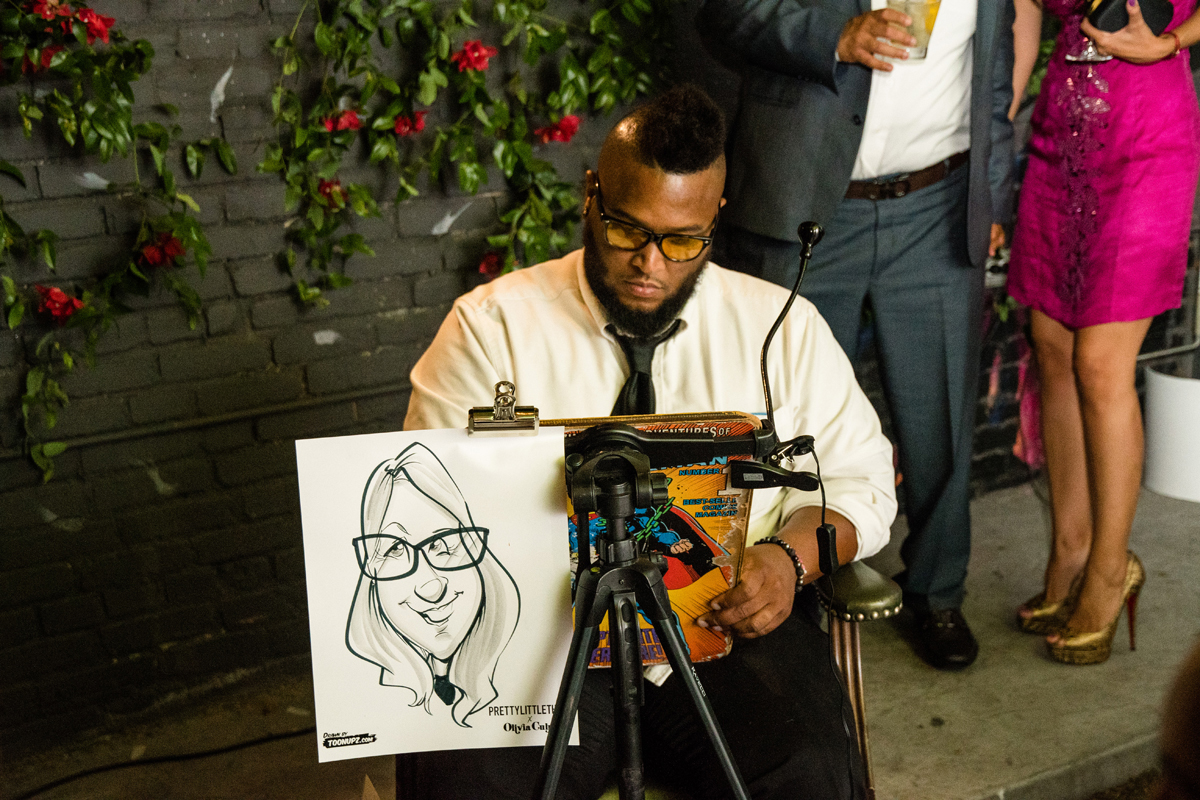 PrettyLittleThing PLT X Olivia Culpo Collection  Celebrity Launch Party caricaturist drawing a guest.jpg