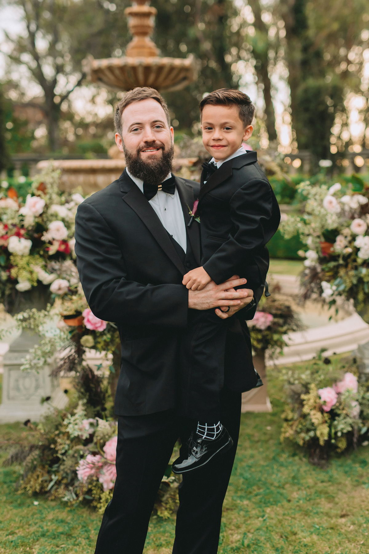 Breathtaking Contemporary Jewel Toned Fall Posh Wedding groom and son ready for ceremony.jpg