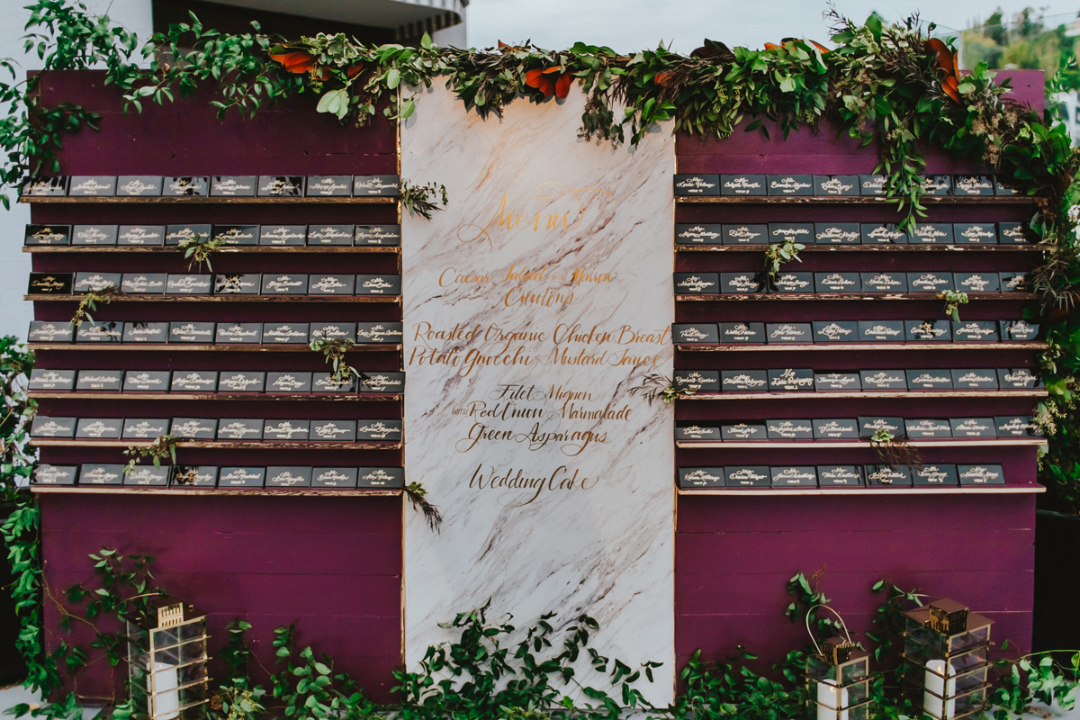 Breathtaking Contemporary Jewel Toned Fall Posh Wedding wall of table numbers and menu.jpg