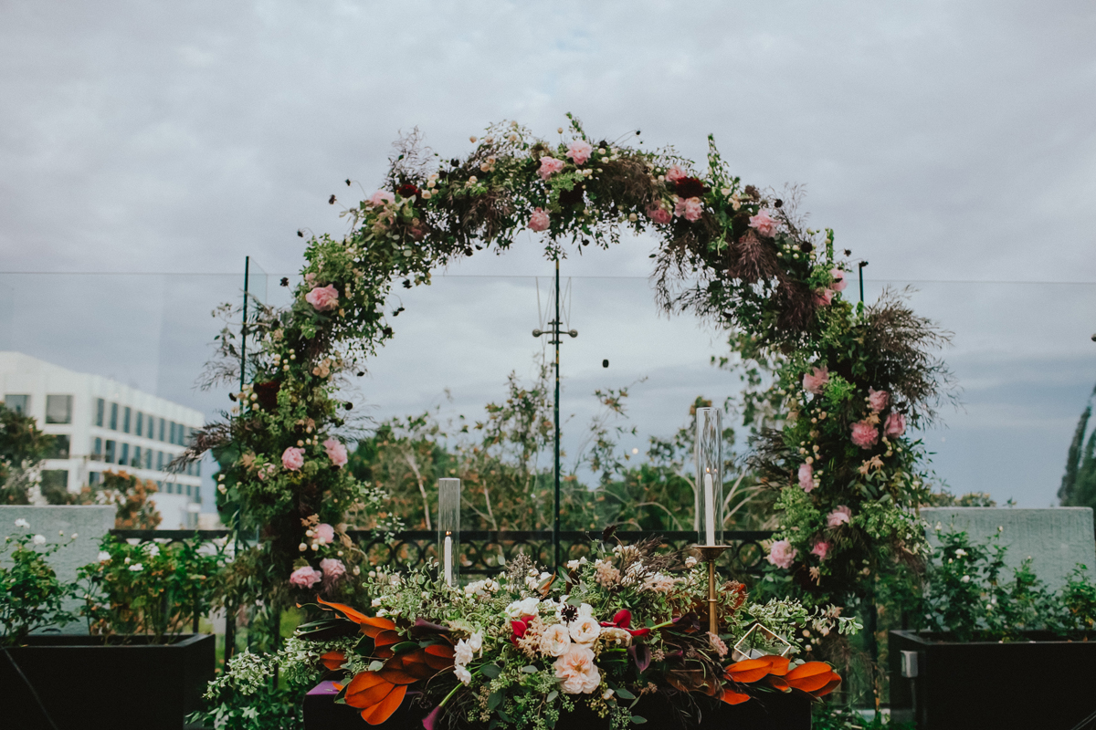 Breathtaking Contemporary Jewel Toned Fall Posh Wedding floral arch.jpg