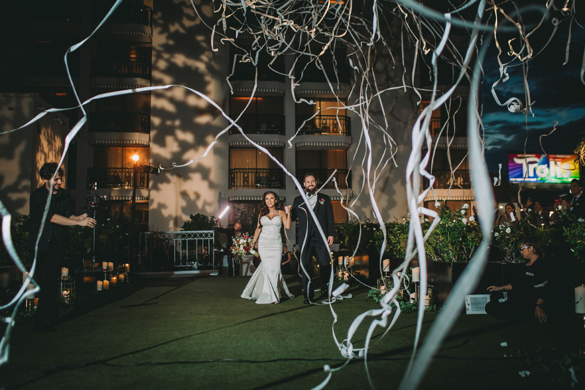 Breathtaking Contemporary Jewel Toned Fall Posh Wedding streamer entrance.jpg