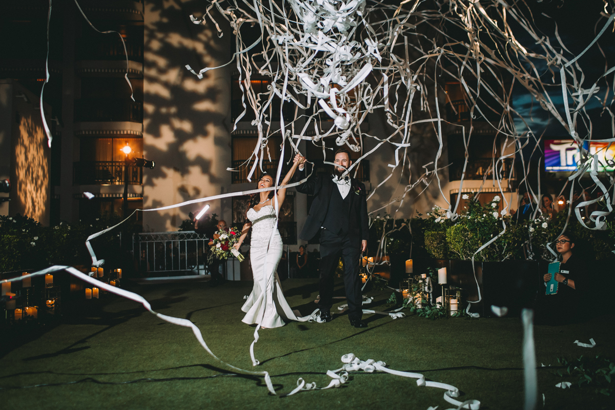 Breathtaking Contemporary Jewel Toned Fall Posh Wedding streamer entrance at dinner.jpg