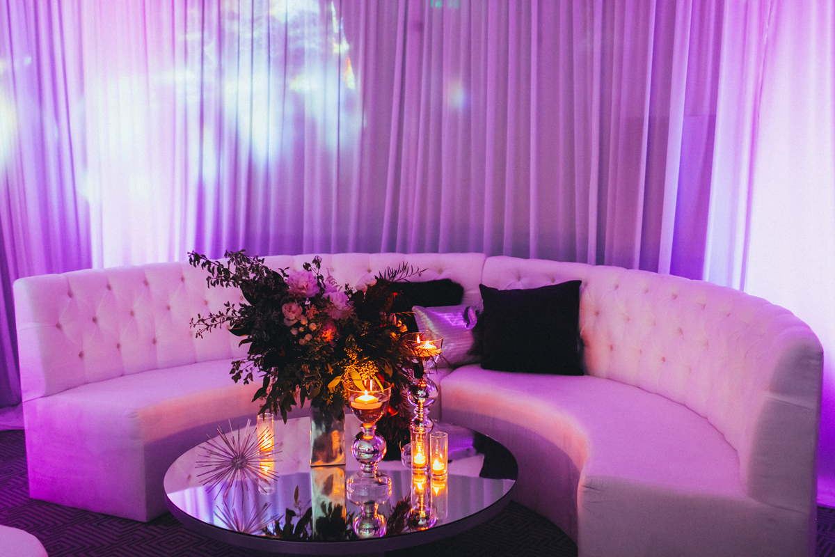 Breathtaking Contemporary Jewel Toned Fall Posh Wedding purple seating area.jpg
