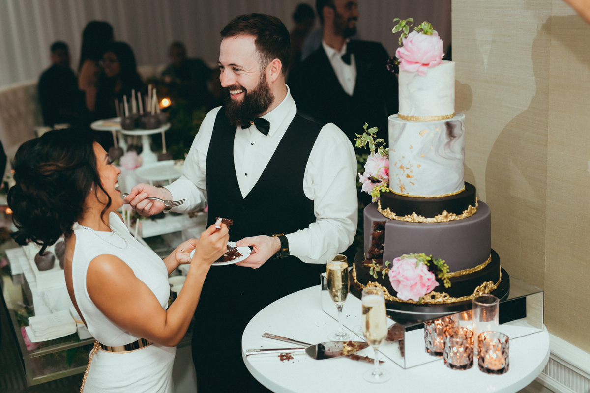 Breathtaking Contemporary Jewel Toned Fall Posh Wedding cutting the cake.jpg