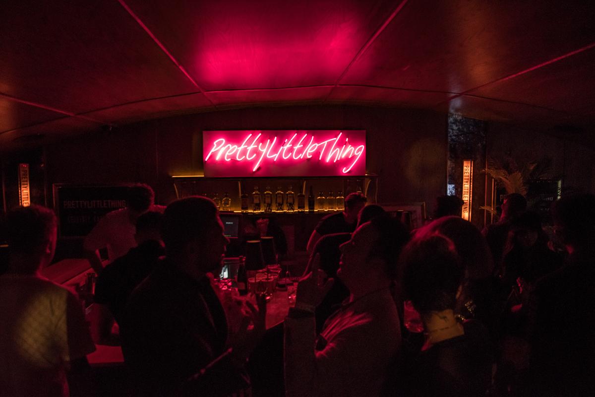 PrettyLittleThing PLT X Kourtney Kardashian Collection Celebrity Launch Party custom marquee at bar.jpg